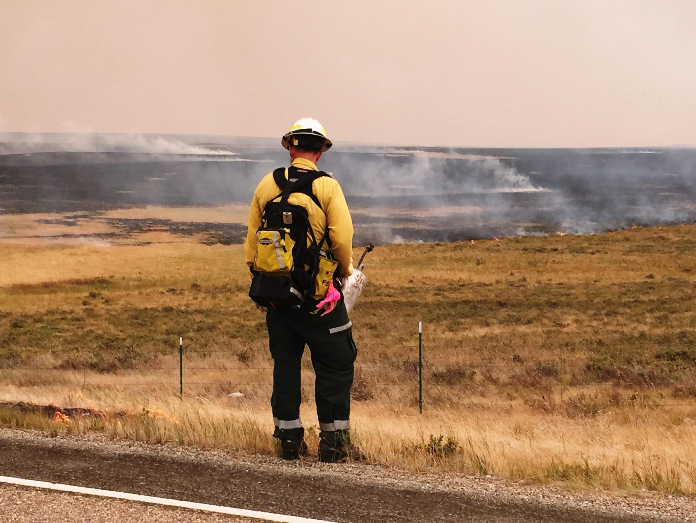A firefighter prepares to work on a burnout operation