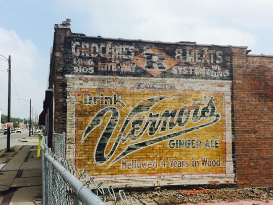 Colors remain bright on an old Vernor's Ginger Ale sign painted on bricks that were recently exposed after a neighboring building was demolished on West McNichols on Detroit's west side.