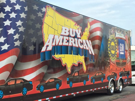 """A semi-truck with the phrase """"Buy American"""" was among the trucks and floats in Detroit's Labor Day parade Monday."""