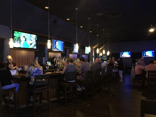 The 48-foot bar and some of the nine TVs in the main dining area of Capaldo's Recovery Room in Penfield.