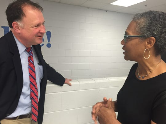 Sen. Creigh Deeds talks with Rev. Sonja Oliver at a Democratic campaign breakfast at Buena VIsta's Parry McClure High School before the start of the town's annual Labor Day parade on Monday.