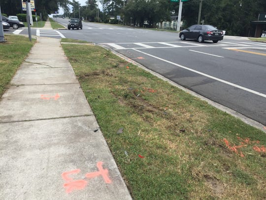 Tallahassee police officers marked the crash site with spray paint as part of a traffic homicide investigation.