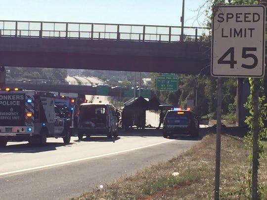 Investigators at a fatal crash scene under the Seminary