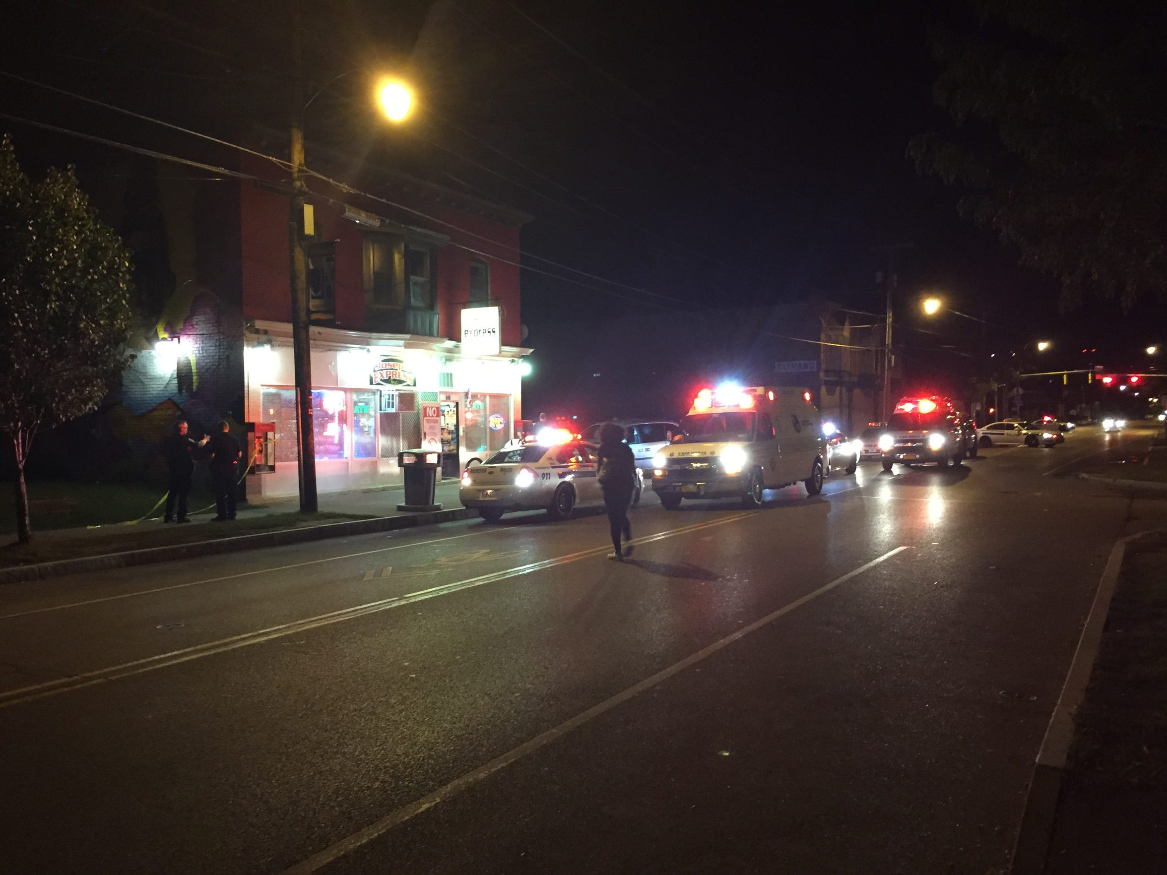 Rochester Police officers investigate a shooting outside of a convenience store on Joseph Avenue on Sept. 10.