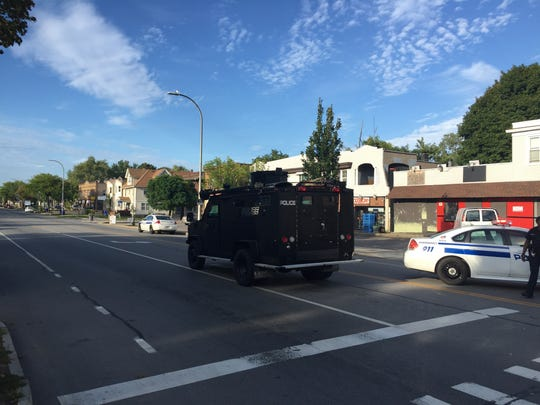 A Rochester Police Department SWAT vehicle rolls into place on Dewey Avenue on Wednesday.