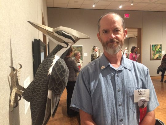 """John Miller stands beside his artwork """"Cock of the Woods"""" at the Leigh Yawkey Woodson Art Museum in Wausau on Sept. 11."""