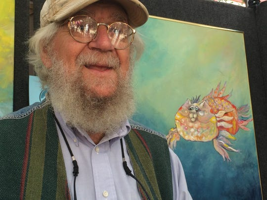 """Don Nedobeck poses for a photo in front of his """"Catfish"""" at Wausau Festival of Arts on Sept. 12."""