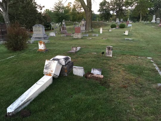 Police say someone tipped over between 50 and 100 tombstones