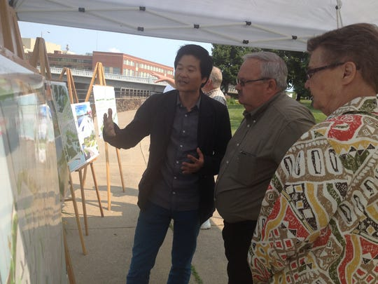 Taewook Cha, principal and founder of Supermass Studio, describing riverfront redevelopment designs to citizens in July.