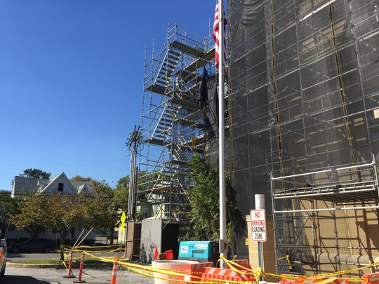 Workers mount scaffolding on Wednesday outside Cumberland