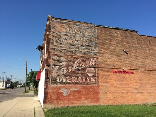 A Carhartt Overalls advertisement, in the company's original font, is seen on a building on Kercheval Avenue near Coplin Street on Detroit's east side.