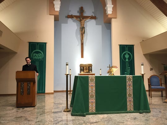 Father Chris Argano poses at Church of St. Columba in Hopewell Junction.