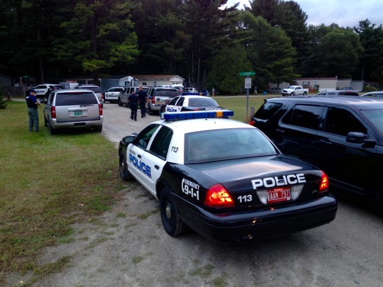 Police units crowd the entrance to Woodland Shores trailer park in Colchester early Sunday morning on Sept. 20.