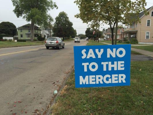 School merger sign
