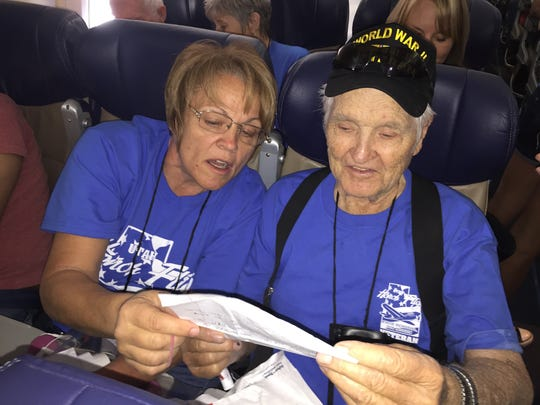 World War II veteran Paul Peterson, left, listens as his daughter Jana Peterson reads him a letter during the Mail Call portion of Utah Honor Flight.