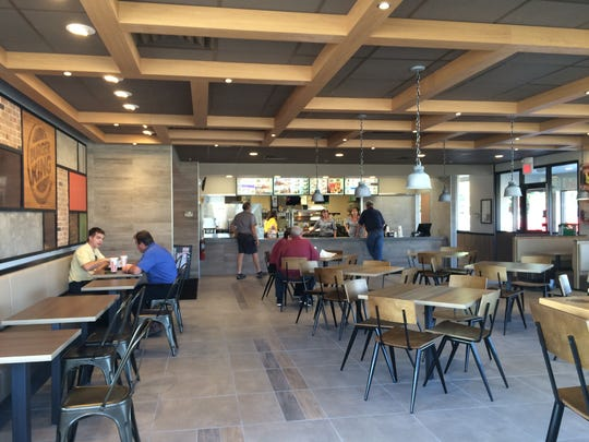 Customer enjoy a meal break at the newly-remodeled Burger King in Wisconsin Rapids.