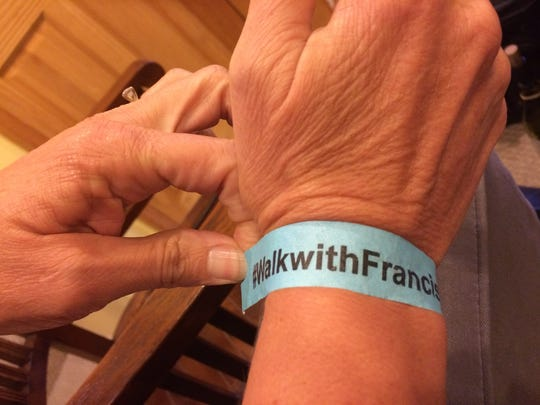 #WalkWithFrancis bracelets were distributed Wednesday in anticipation of Pope Francis' visit.