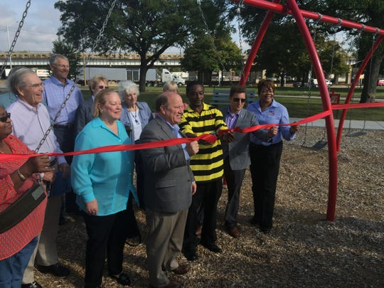 Mayor Mike Duggan joins with park supporters and descendants of the late William Knudsen to celebrate the renovation of Knudsen Park near 8 Mile and I-75 in Detroit on Friday, Sept. 25, 2015.