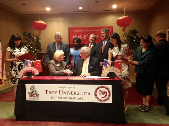 Pike Road Schools Superintendent Suzanne Freeman signs the documents with Troy Chancellor Dr. Jack Hawkins