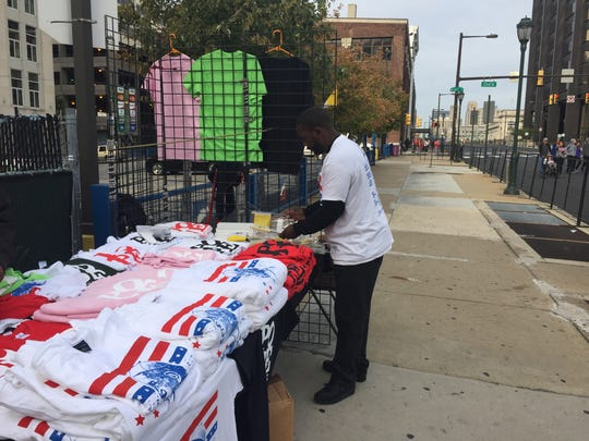 Khalil Robinson, one of 250 people with a Center City vendor license, sets up his stand with homemade Pope t-shirts near 22nd and Market Streets.