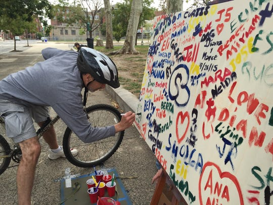 Michael Gagliardi signs a public art project in Old