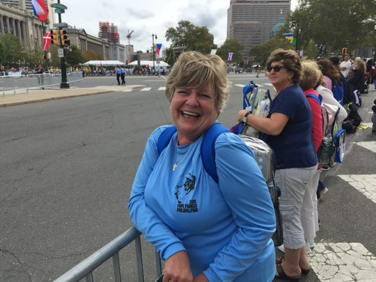 Anne Kirby of Manville New Jersey stands eagerly along the edge of the Parkway hoping to catch a glimpse of the pontiff.
