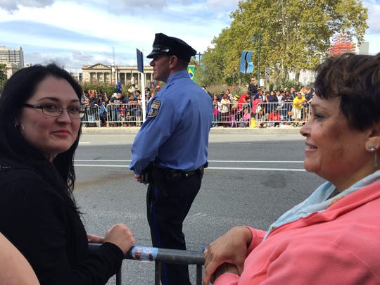 Marlene Lopez and her aunt Lucy Lopez of Philadelphia have been waiting along the Ben Franklin Parkway for the last three hours to get a good view for when Pope Francis passes by during the parade.