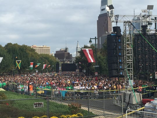 Those gathered on the Parkway have turned their attention to TV screens broadcasting the pope's address at Independence Mall.