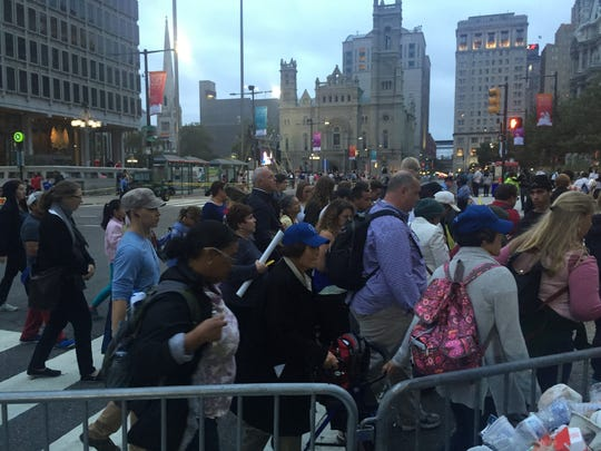 People leaving the parkway and walking toward 30th Street station in Philadelphia.
