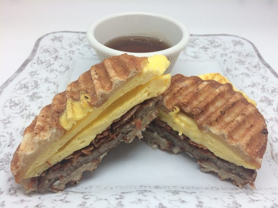 The Bronut, a sandwich of sausage, bacon, egg and cheese on a grilled Kronut, is on the breakfast menu at White Buftterfly Cafe in Jackson.