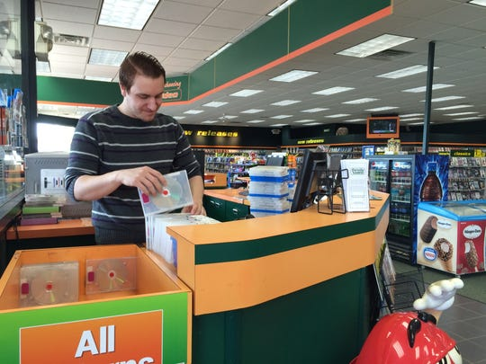 Jake Jeffers, Family Video manager, sorts returns early Monday.