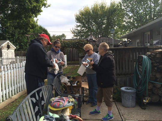 """Mike Wolosek, far left, helps volunteers decorate Wolosek's yard on Gaynor Avenue for the annual """"Fright for Life"""" Halloween Aid benefit."""