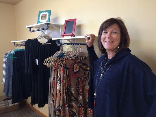Kara Sams models clothing and jewelry available at