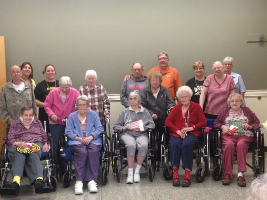 The winners of the senior art awards at the Algoma Long-Term Care Center were presented with their awards by Mayor Wayne Schmidt.  (Front, left to right) Emma W., Carol M., Myra S.,  Norma M., and Lorraine Massart.  (Back row, left to right) Gary Carlton, Melissa Yedica, Rachel Harmann, Minnie H., Jean W., John A., Laverne B, Mayor Schmidt, LuAnn Dellis, Dianne B, Mary Donaldson.