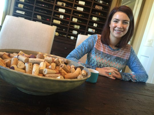 Elizabeth Turner sits in her parents home in Rib Mountain. The bowl of corks signifies her creative side - she created it when she was a student at Wausau East High School.