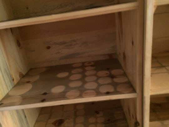 Soot is visible on shelves that have been cleared of