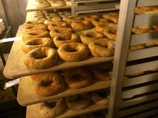 Racks of bagels rest in the cooler for about 24 hours before being boiled and baked at The Bagel Factory.