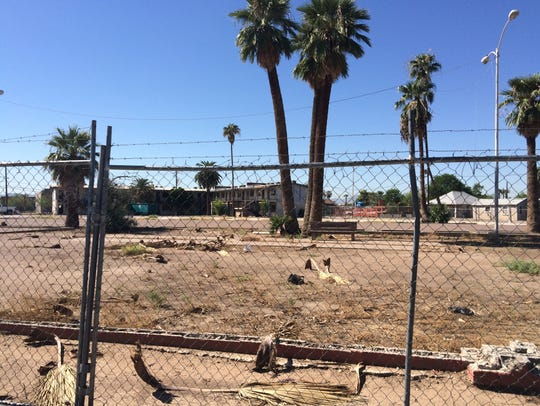 A number of blighted lots greet drivers along Grand