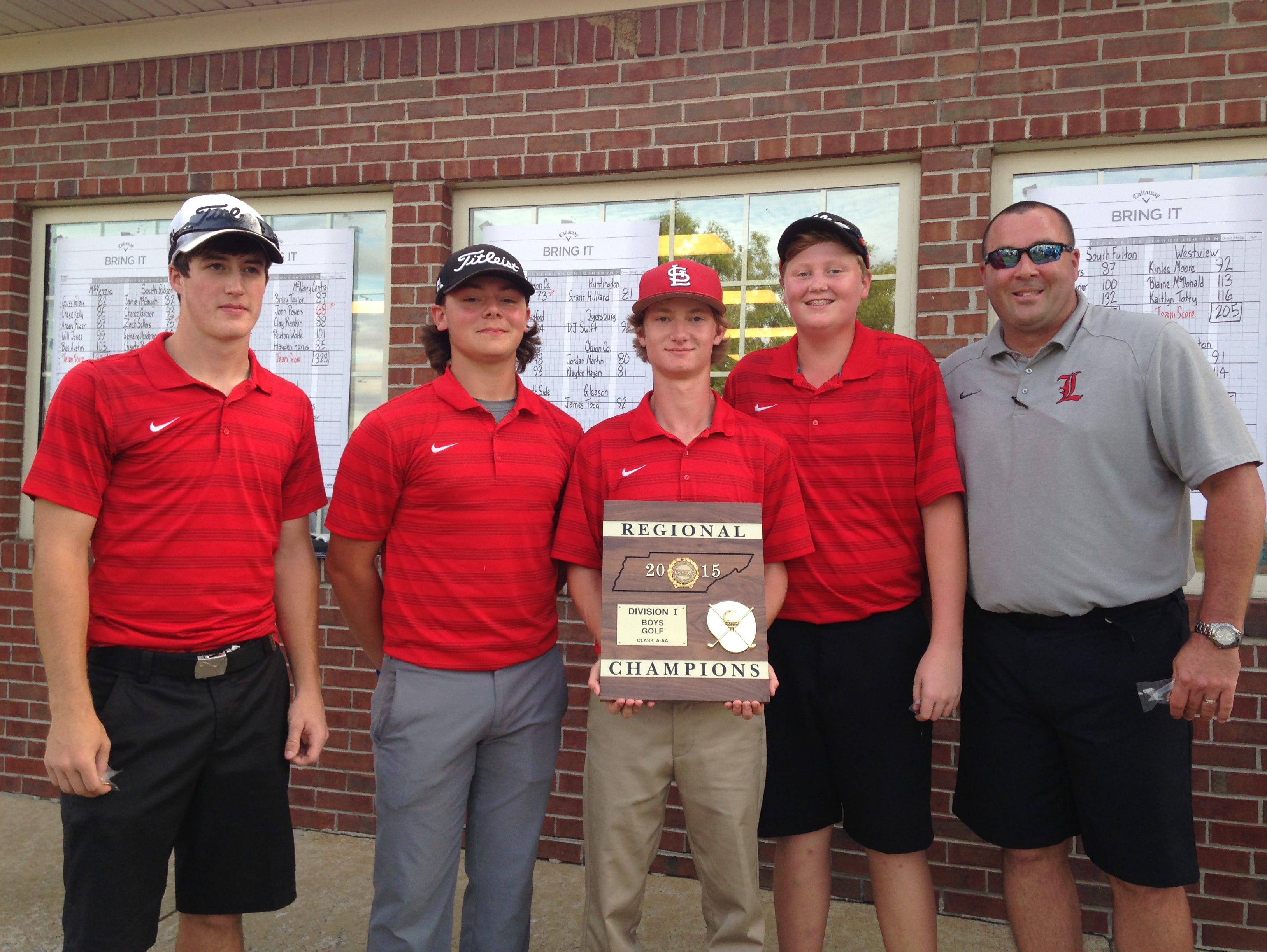 Lexington's boys pose with the region title trophy after beating Westview in a playoff Monday in Dyersburg.