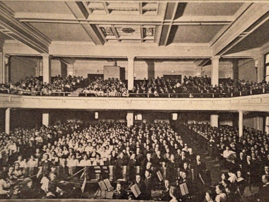 Students in the auditorium in this 1920 photo.