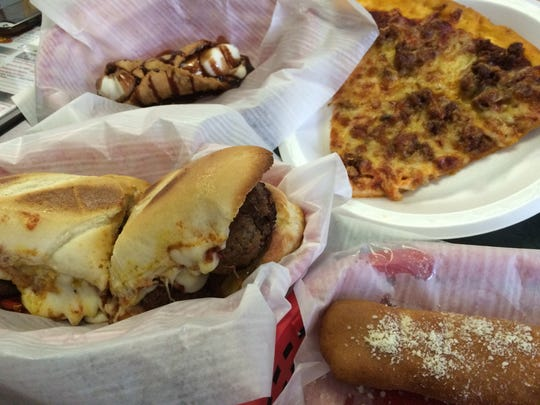 A meatball sandwich, an order of cannoli, a slice of sausage pizza and a cheese-filled Bosco stick at Bordy's Pizza in the Drake Neighborhood.