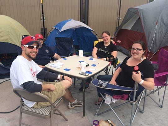 Amy Brandt of Des Moines, Jens Hansen of Ankeny, Eric Coop of Urbandale and Andrea Curtis of Des Moines are part of the first 65 adults to camp out for a year's free Chick-fil-A.