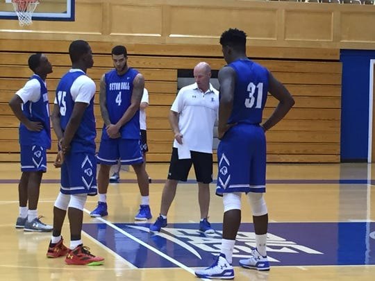 Seton Hall coach Kevin Willard instructs his players,