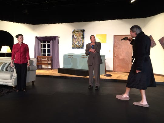 """Mozelle Stoiber, (from left) Joel Goodness and Mark Vicker rehearse a scene from the """"Art of Murder."""""""