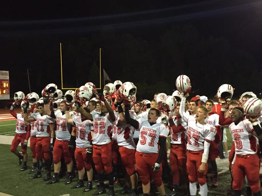 Port Clinton celebrates its victory Friday over Huron with its fans and band.
