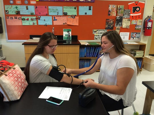 Alexis Geary takes Ashlee Leith's blood pressure during