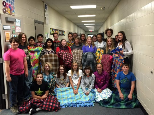 The eighth-grade Family and Consumer Science class at Sartell Middle School who made blankets to donate. Pictured in Row 1 are Jackson Brown, Emma Harris, Tianna Korte, Hailey Evans, Hailey Ogle and Christopher Larson. In Row 2 are Tom Schultz, Raven Vastag, Farzana Qureshi, Kendra Dehn, Michael Stredelman, Victoria Clemens, Kautra Grant, Michala Van Heel and Raina Ruff. In Row 3 are Abdul Wadood, Justin Clauson, Lucas Nistler, Ethan Hubert, Anna Yarmon, Emily Domres, Mikayla Emslander, Rachel Klehr and Mylesha Mugg. Not pictured: Brady Baxter and Ryan Spies.