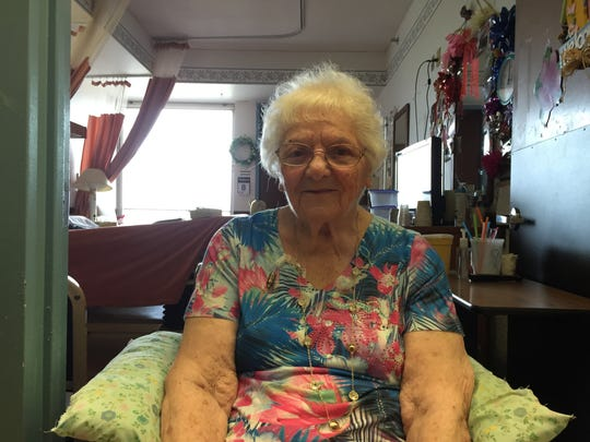 """Ida Vigliotti sits outside her room at the Summit Park Hospital and Nursing Care Facility in Ramapo. She's hoping her friends, called """"The Stoop Group,"""" will be able to stay together once they leave."""