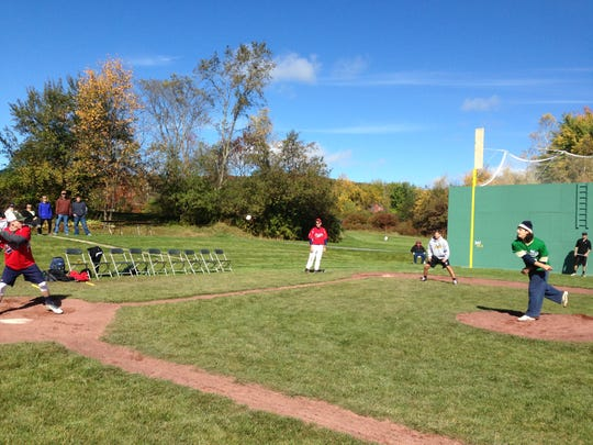 Nick DiBenedetto, Trinity College shortstop, on the mound at Little Fenway Saturday, competing in a whiffle ball tournament to benefit Strike 3 Foundation. DiBenedetto's team advanced to the championship game.
