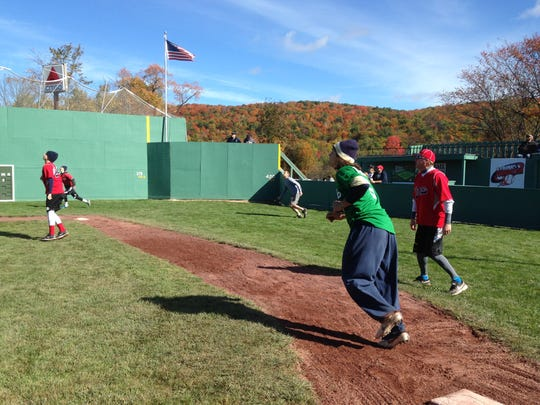 Nick DiBenedetto, green jersey, running the bases Saturday in a whiffle ball game at Little Fenway in Essex. He plays shortstop for the Trinity College Bantams.